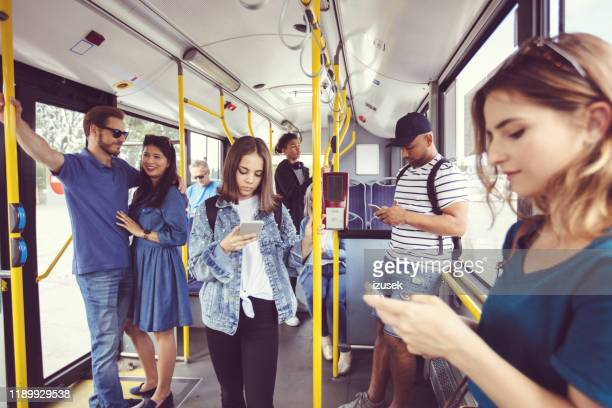 people commuting by public transport - izusek stock pictures, royalty-free photos & images