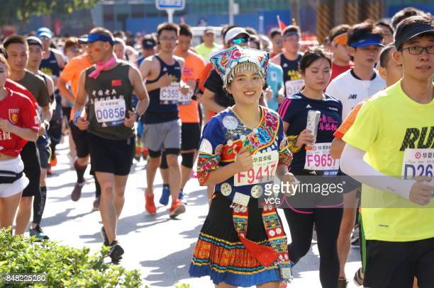 People compete during the Beijing Marathon 2017 on September 17 2017 in Beijing China