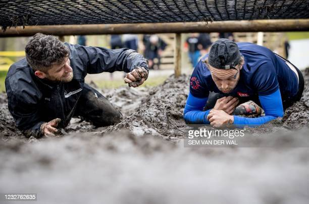 """People compete in the """"Mud masters"""" Fieldlab trial event Mud Masters in Amsterdam, on May 8, 2021. - The Netherlands is currently under a national..."""