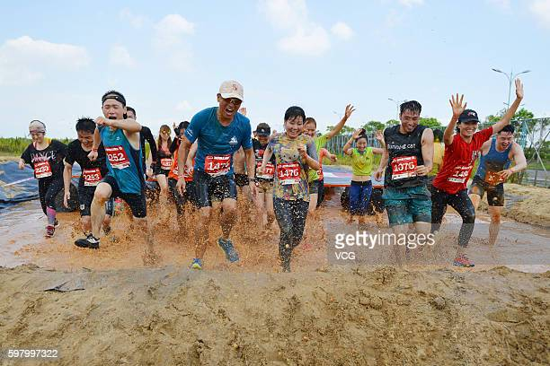 People compete in the Mud Run on August 27 2016 in Shanghai China About 2000 Chinese and foreigners participated in the 2016 Mud Run Shanghai Tour...