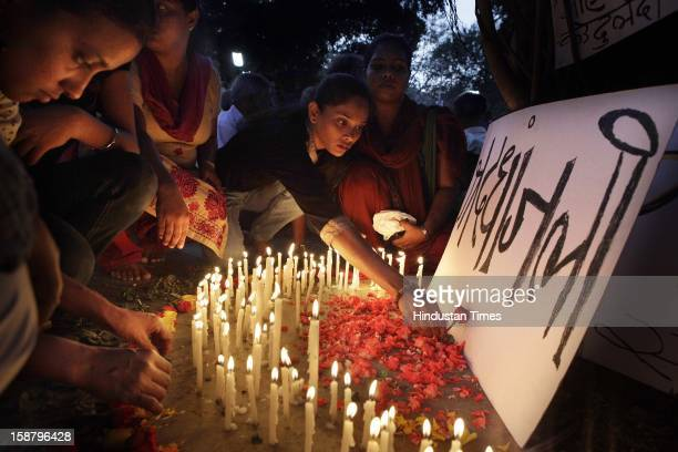 People condole by lighting candles for the death of Delhi rape case incident victim at Dadar on December 29 2012 in Mumbai IndiaThe girl died of...