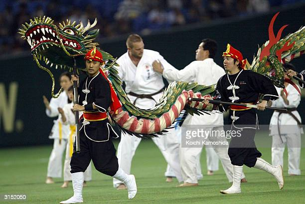 People conduct the dance of Okinawa, Japan during a ceremony before an exhibition game against the Tampa Bay Devil Rays vs the Yomiuri Giants on...
