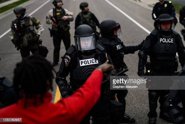 People confront police on April 11, 2021 in Brooklyn Center, Minnesota. Protesters took to the streets today after 20 year old Daunte Wright was shot...