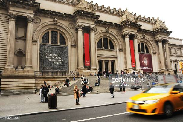 People congregate at the entrance to the Metropolitan Museum of Art on March 1 2017 in New York City Thomas Campbell the director and CEO of the Met...