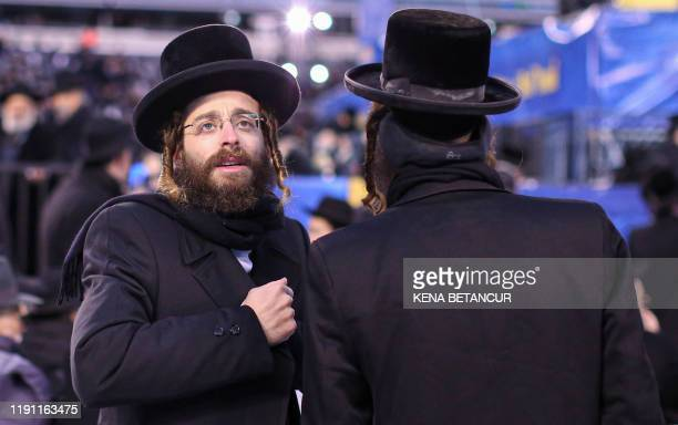 People congregate at the MetLife Stadium to celebrate Siyum HaShas the completion of the reading of the Babylonian Talmud on January 1 in East...