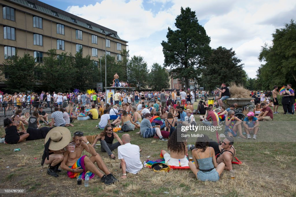 People Congregate At Victoria Gardens During The Brighton Pride Parade And  Carnival On The 4th August Images