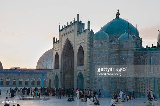 People congregate outside the Blue Mosque the 12th century structure and compound September 15 2016 in MazarI Sharif Afghanistan It is believed the...