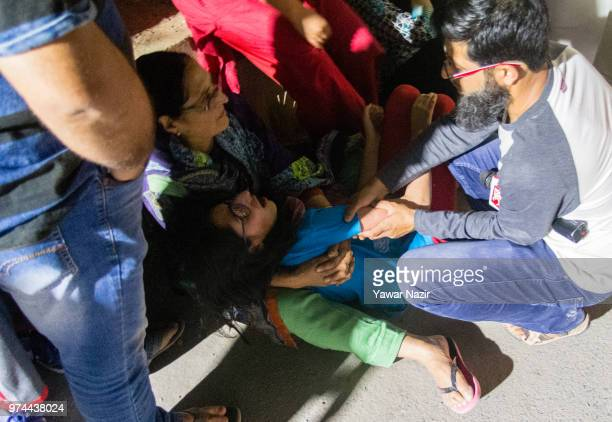People console daughter of Syed Shujaat Bukhari the editor of Rising Kashmir daily newspaper killed by unidentified gunmen outside his office on June...