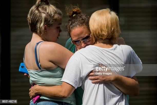 People console each other outside of the Burnette Chapel Church of Christ on September 24 2017 in Antioch Tennessee One person was killed and seven...