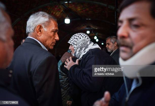People console Louai al-Nuaimi , father of two Iraqi youngsters, Omar and Ali, killed in Baghdad's twin suicide attacks, during a condolences...