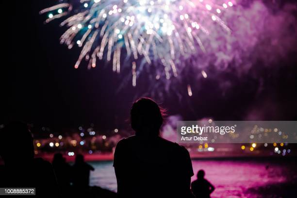 people contemplating fireworks. - fireworks stock pictures, royalty-free photos & images
