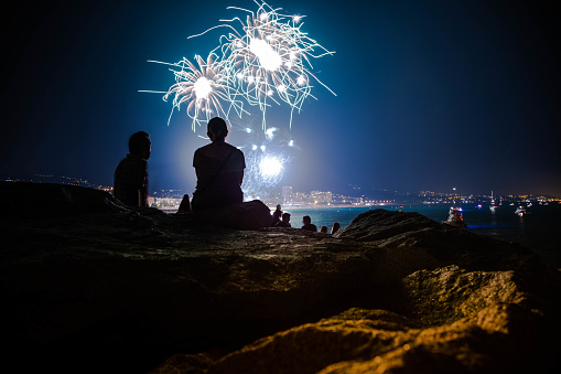People contemplating fireworks. - gettyimageskorea