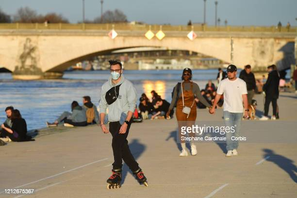 People continue to gather at the Quays of Seine despite French Prime Minister Edward Philippe announced that France will shut most shops restaurants...