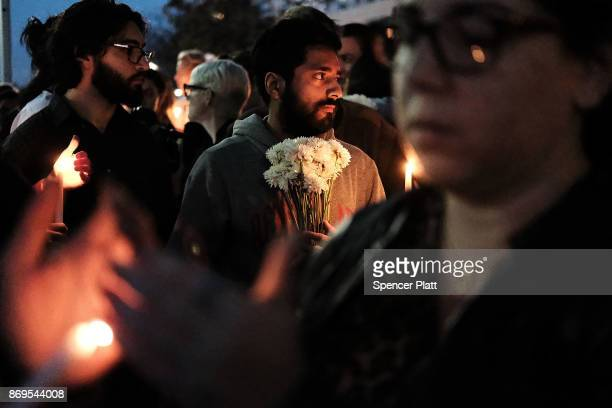 People converge with candles for a vigil to walk along a bike path in Lower Manhattan on November 2 2017 in New York City Eight people were killed...