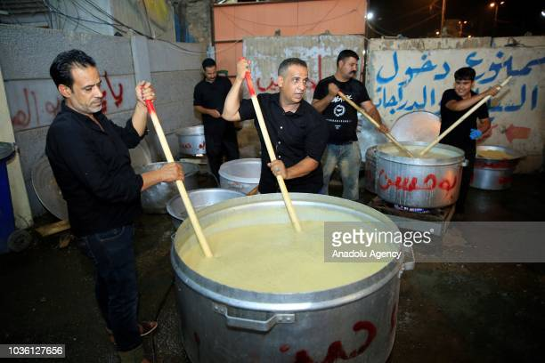 People cook ashura as part of the holy month of Muharram commemorations in Baghdad Iraq on September 19 2018 Ashure or Noah's Pudding dessert...