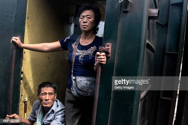 People cool down at a train carriage door on August 24 North Korea North and South Korea today came to an agreement to ease tensions following an...