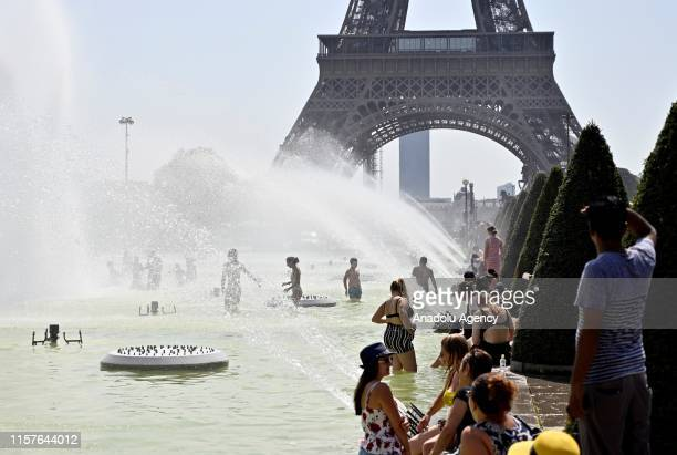 People cool down at the fountains of Trocadero near Eiffel Tower during a heatwave in Paris, France on July 25, 2019.