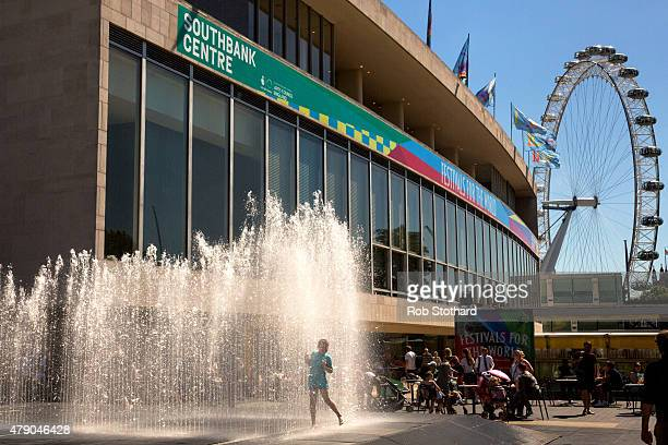 People cool off in a fountain outside the Southbank Centre on June 30 2015 in London England The UK is currently experiencing a heatwave with...