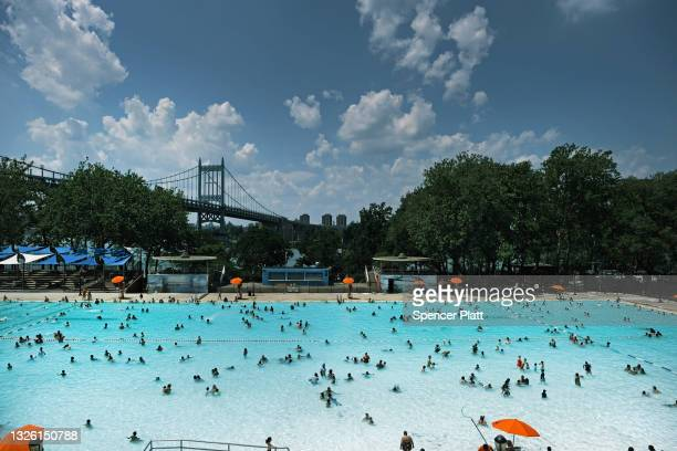 People cool off in a public swimming pool on June 29, 2021 in the Astoria neighborhood of the Queens borough in New York City. New York City is under...