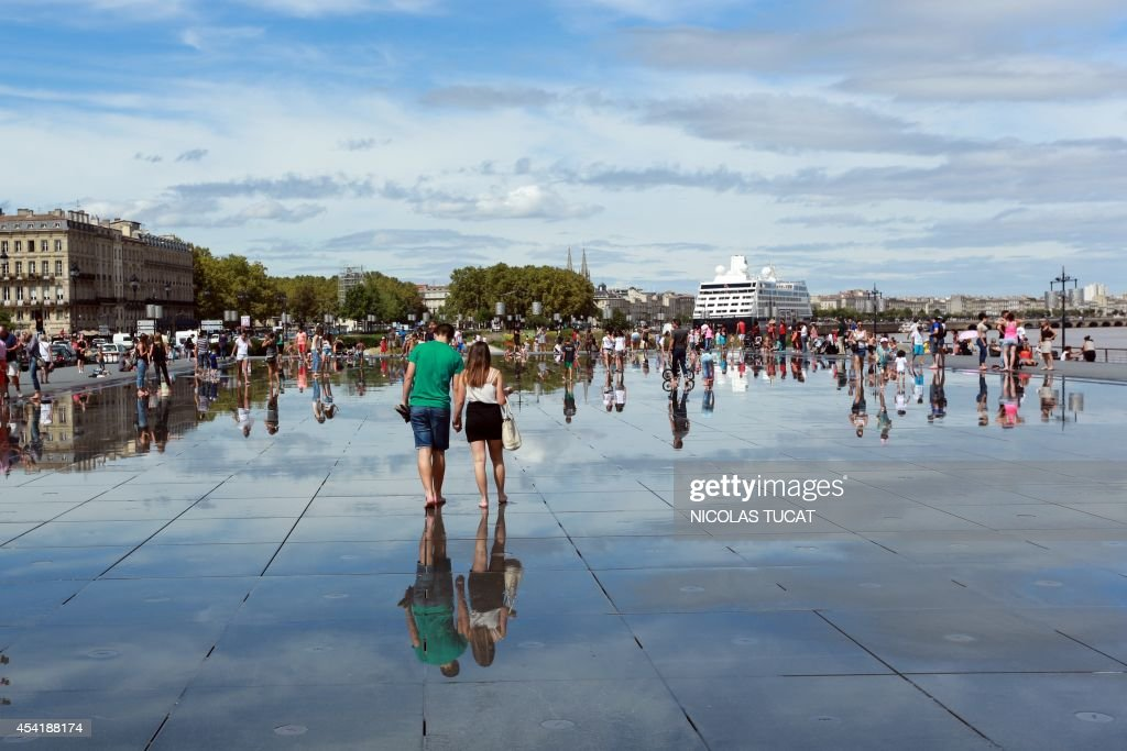 People cool off in the Water Mirror on August 25, 2014 in the southwestern French city of Bordeaux
