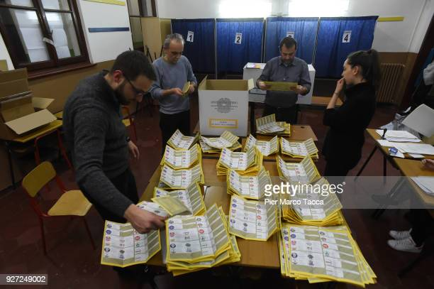 People count ballot papers in a polling station during the 2018 general election on March 4 2018 in Milan Italy The economy and immigration are key...