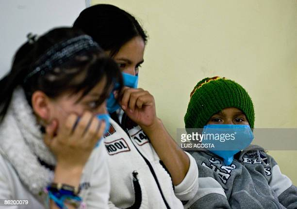 People cover his face with scarfs to protect themselves from the virus of swine flu at the Mixcoac health center In Mexico city on April 24 2009An...
