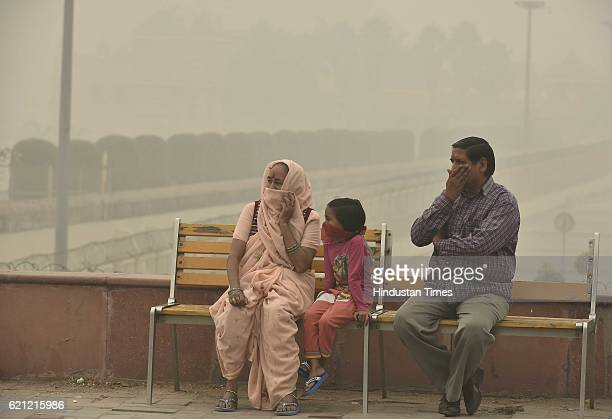 People cover their face with mask to avoid thick smog this evening as the whole city is engulfed in heavy smog air quality deteriorated sharply...