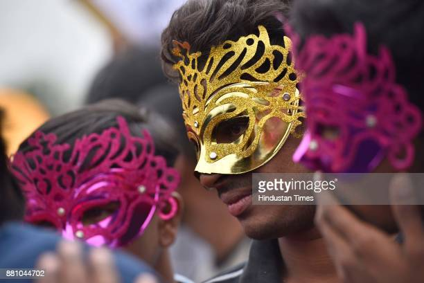 People cover their face with mask while participating in the 10th year celebration of Namma Pride and Karnataka Queer Habba on November 26 2017 in...