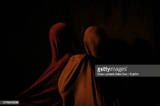 people covered in textile against black background - lorraine smothers stock pictures, royalty-free photos & images