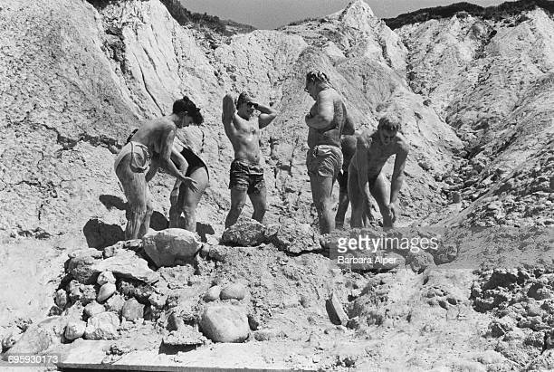 People covering themselves in clay at Moshup's Beach at the Gay Head Cliffs near Aquinnah Massachusetts August 1989 This practise is no longer...