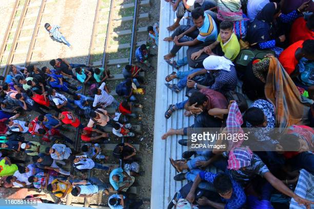 People cram onto a train to travel back home to be with their families ahead of the Muslim festival of Eid al-Adha in Dhaka. Muslims around the world...