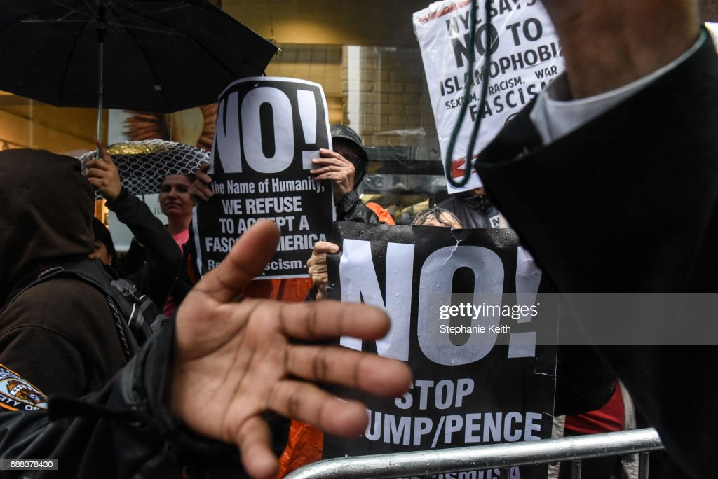People critical of U.S. President Donald Trump counter-protest during an Alt Right protest of Muslim Activist Linda Sarsour on April 25, 2017 in New York City.