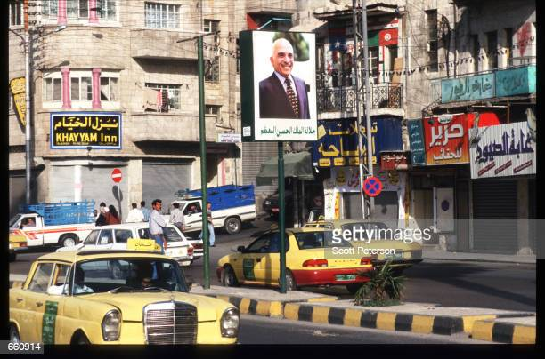 People cross a busy street May 17 1998 in Amman Jordan Still a teenager when crowned in 1952 King Hussein has led the young Arab nation through brief...