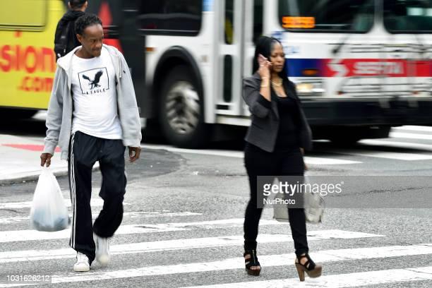 People cross a Center City street in Philadelphia Pa on September 11 2018