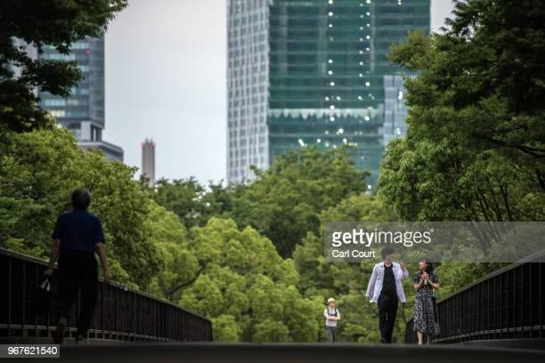 People cross a footbridge in Yoyogi Park on June 5, 2018 in Tokyo, Japan.