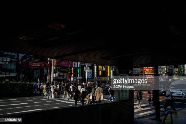 People cross a road at the Shinjuku in Tokyo Tokyo is Japan's capital and one of the world's most populous metropolis