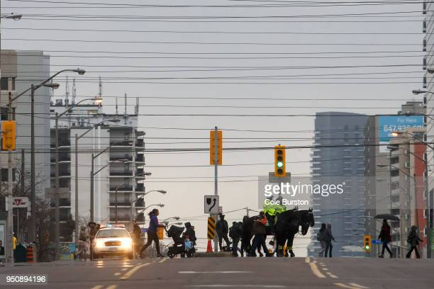 People cross at the intersection of Yonge Street and Finch Avenue on April 24 2018 in Toronto Canada A suspect identified by police as Alek Minassian...
