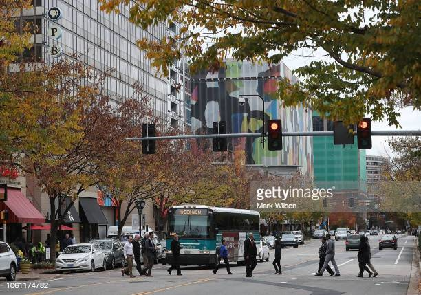 People cross Crystal Drive near the 1851 S Bell Street building in the Crystal City area on November 13 2018 In Arlington Virginia Amazon announced...