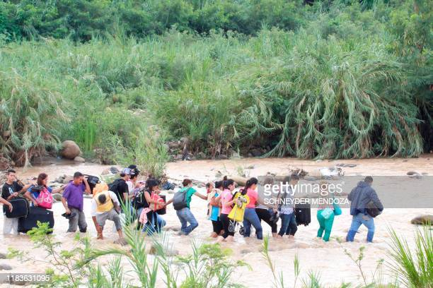 "People cross from San Antonio del Tachira in Venezuela to Cucuta in Colombia through ""trochas"" -illegal trails- near the Simon Bolivar international..."