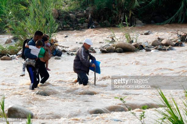 "People cross from San Antonio del Tachira in Venezuela to Cucuta in Colombia through ""trochas"" -illegal trails- near the Simon Bolivar international..."