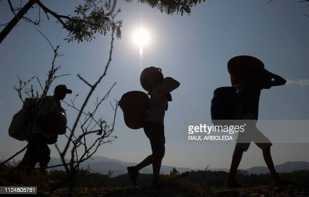 TOPSHOT People cross from Venezuela through Trochas illegal trails near the Simon Bolivar International Bridge in Villa del Rosario Norte de...