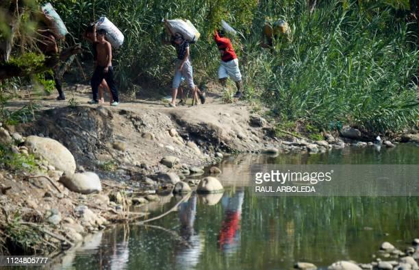 People cross from Venezuela through Trochas illegal trails near the Simon Bolivar International Bridge in Villa del Rosario Norte de Santander...