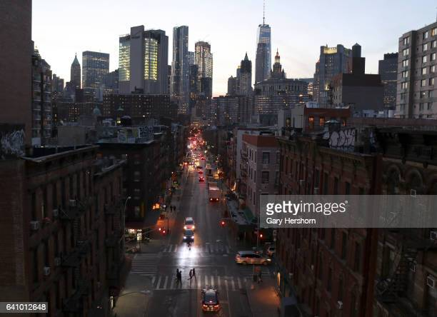 People cross Henry Street in Chinatown as the sun sets on Lower Manhattan on February 4, 2017 in New York City.