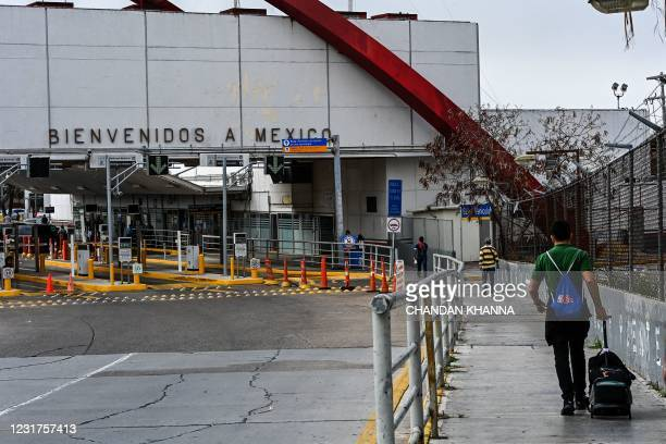 People cross the border at the Gateway International Bridge into Matamoros, Mexico, from Brownsville, Texas, on March 15, 2021. - It's the new normal...