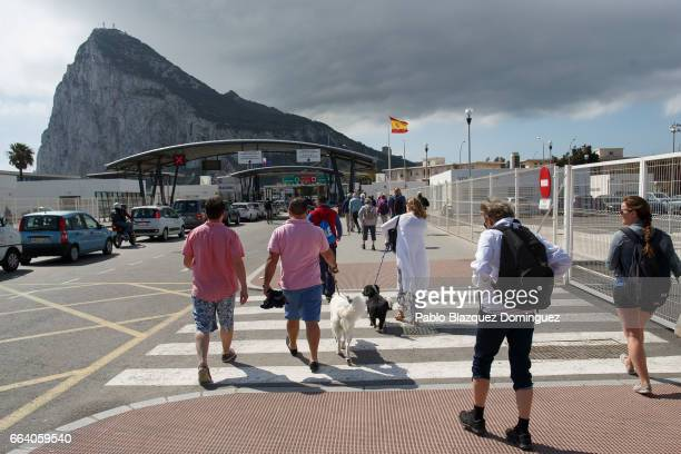 People cross the border from Spain to Gibraltar on April 3 2017 in La Linea de la Concepcion Spain Tensions have risen over Brexit negotiations for...