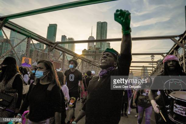 People cross the Brooklyn Bridge demanding police reform after a commemoration to honor the anniversary of George Floyd's death on May 25 in New York...