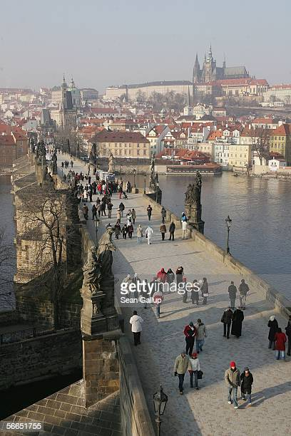 People cross the Charles Bridge January 23 2006 in central Prague Czech Republic Austrian composer Wolfgang Amadeus Mozart stayed and composed in...