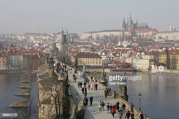 People cross the Charles Bridge January 23, 2006 in central Prague, Czech Republic. Austrian composer Wolfgang Amadeus Mozart stayed and composed in...