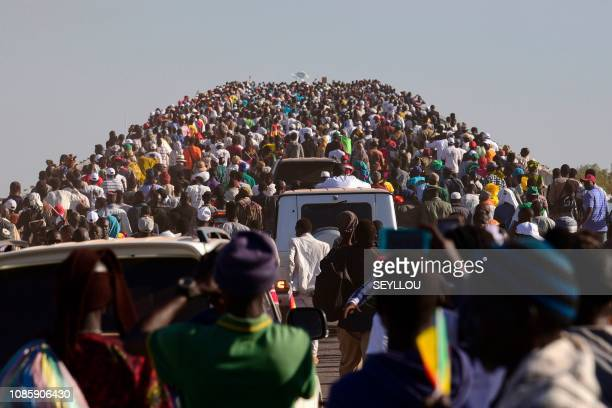 People cross the Farafenni Bridge after its inauguration by Senegal's president and Gambia's President on January 21 in Farafenni The bridge was...