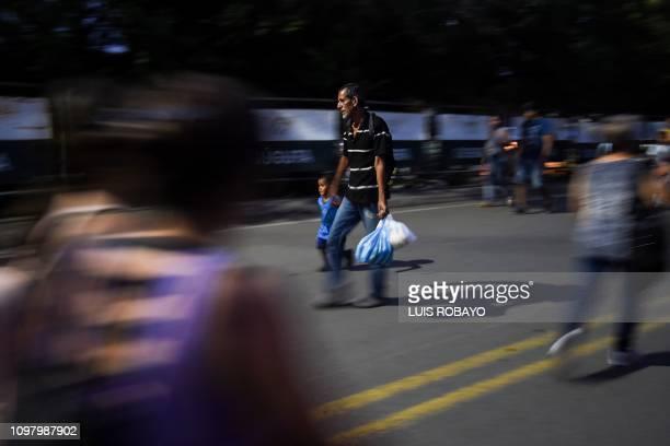 TOPSHOT People cross the Francisco de Paula Santander International Bridge between Cucuta Venezuela and Urena Venezuela on February 11 2019 Several...